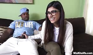 sweetie Mia Khalifa supplies a tugjob to a huge-dicked ebony stud for starters