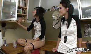 attractive emo females are drilling in the college kitchen